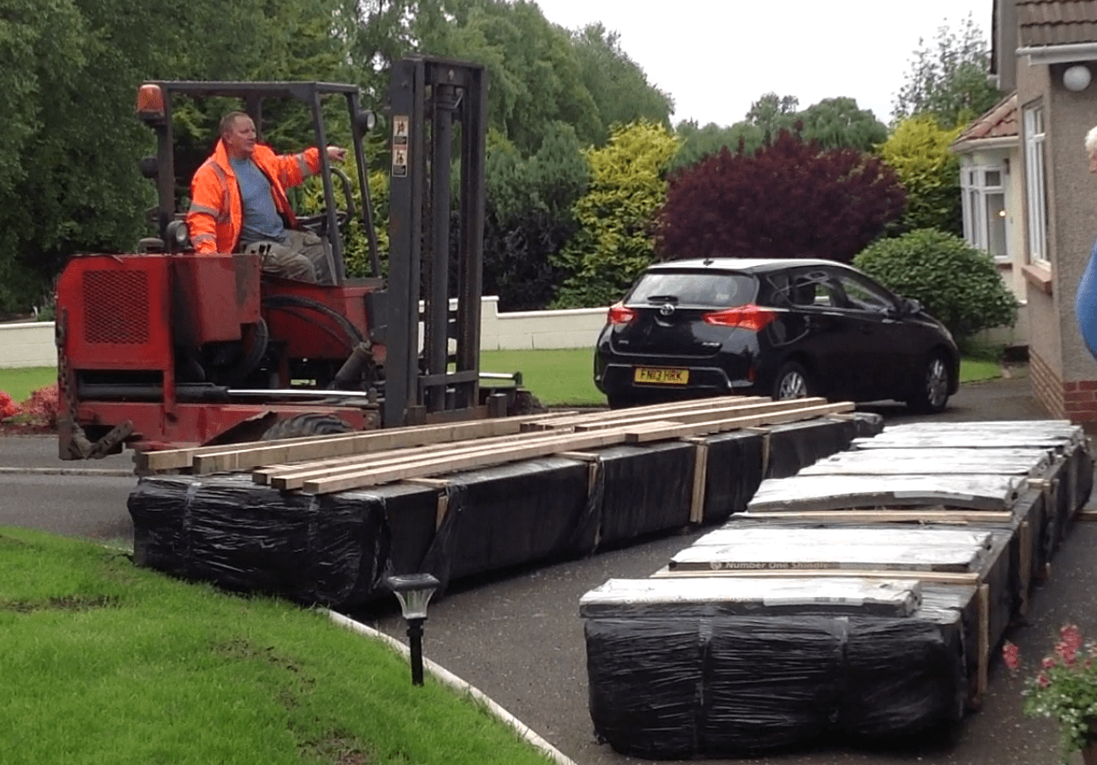 Moffett forklifts deliver our log cabins