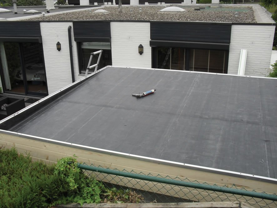 EPDM roofing material for flat roofs such as log cabins.