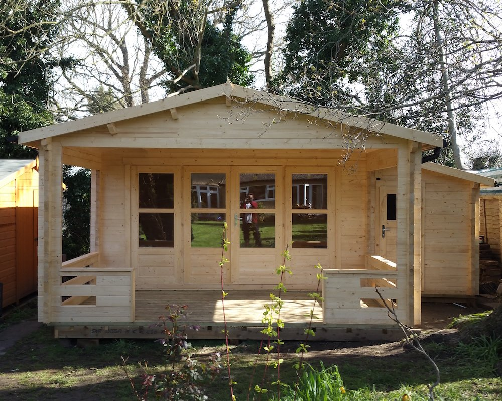 Manchester log cabin. 58mm log with a side shed