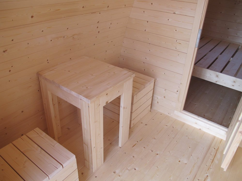 Camping pod benches in the lobby area.