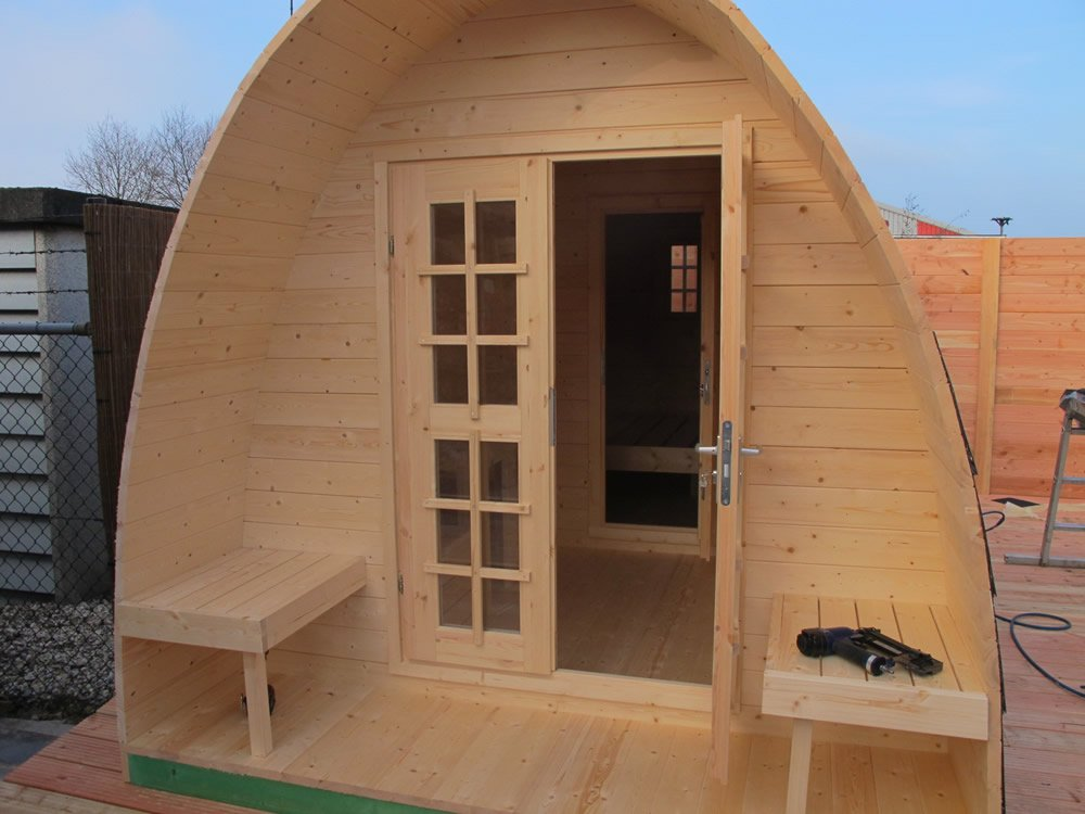 Log cabin camping pod showing a building being installed 480cm version