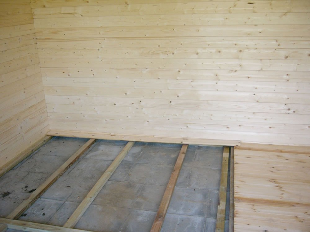 Wooden floor pack for log cabins for How to build a cabin floor