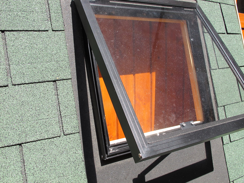 Log cabin skylight roof vent