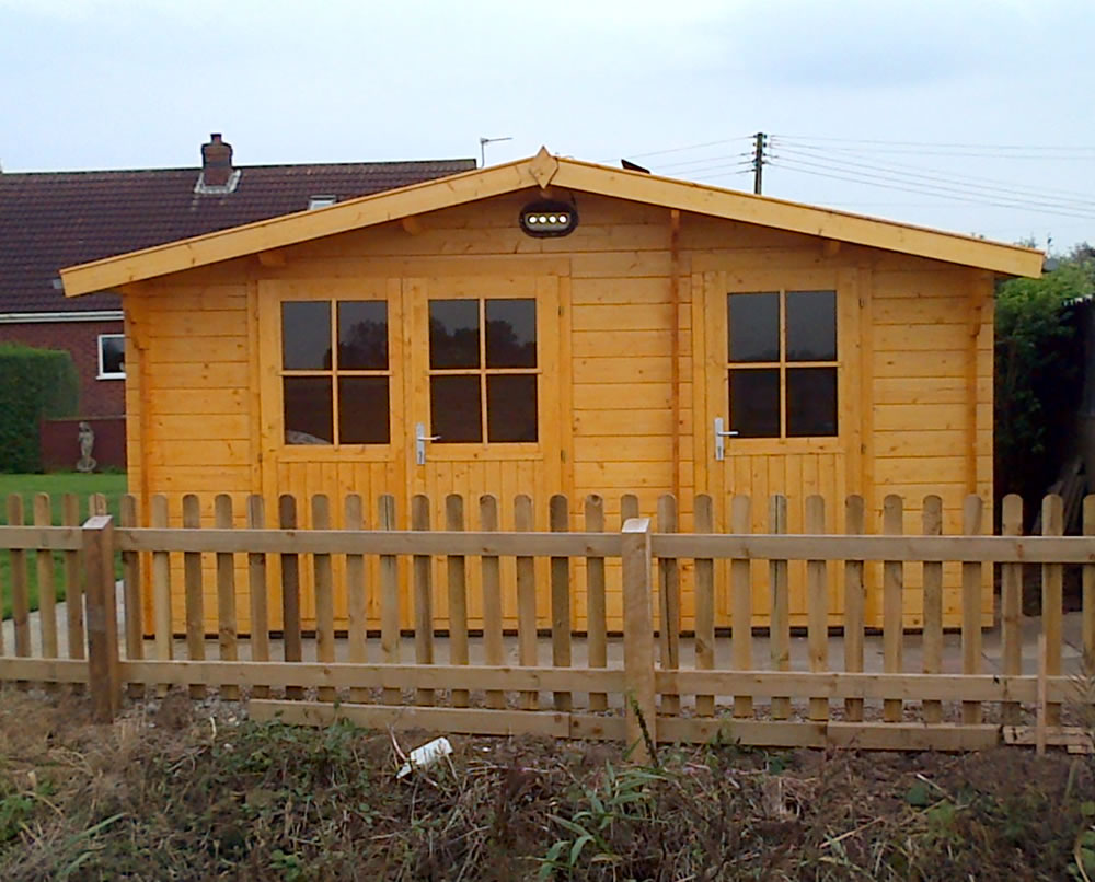 Lukas log cabin with side shed