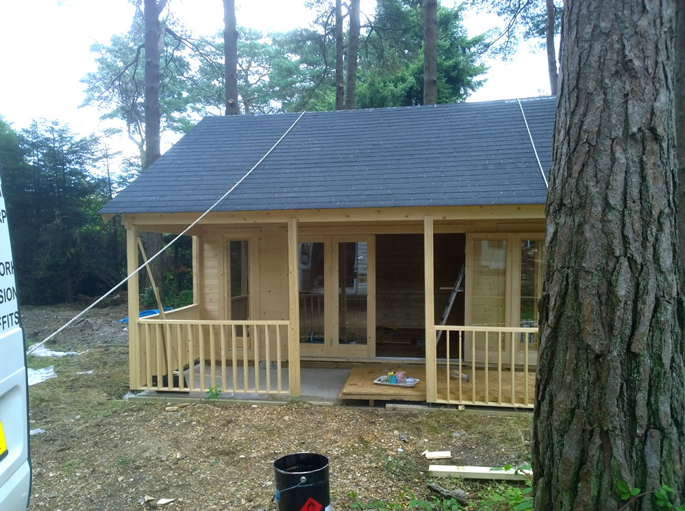 Olaug log cabin in 45mm logs with bi-folding doors