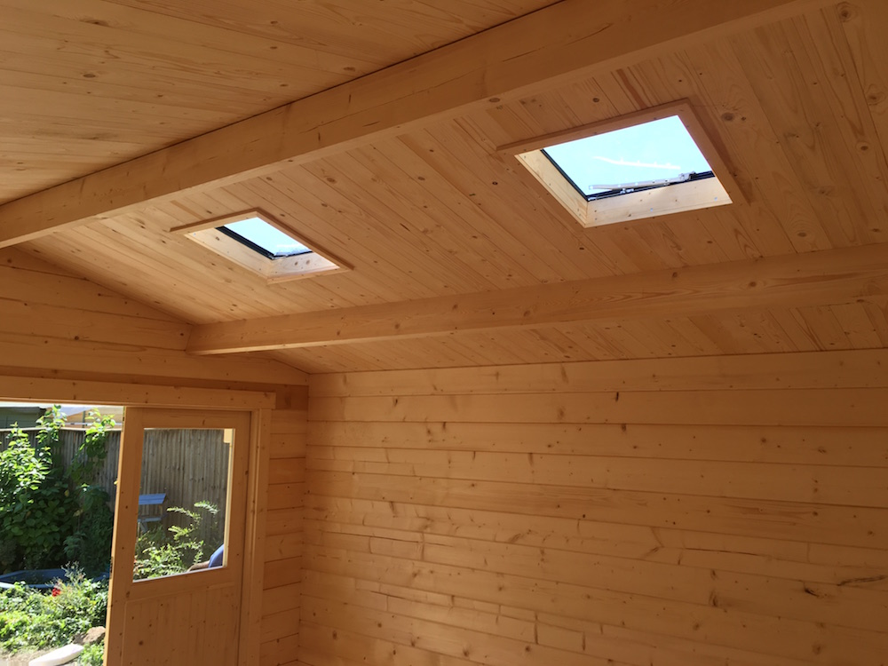 Log Cabin skylight fitted with roof insulation