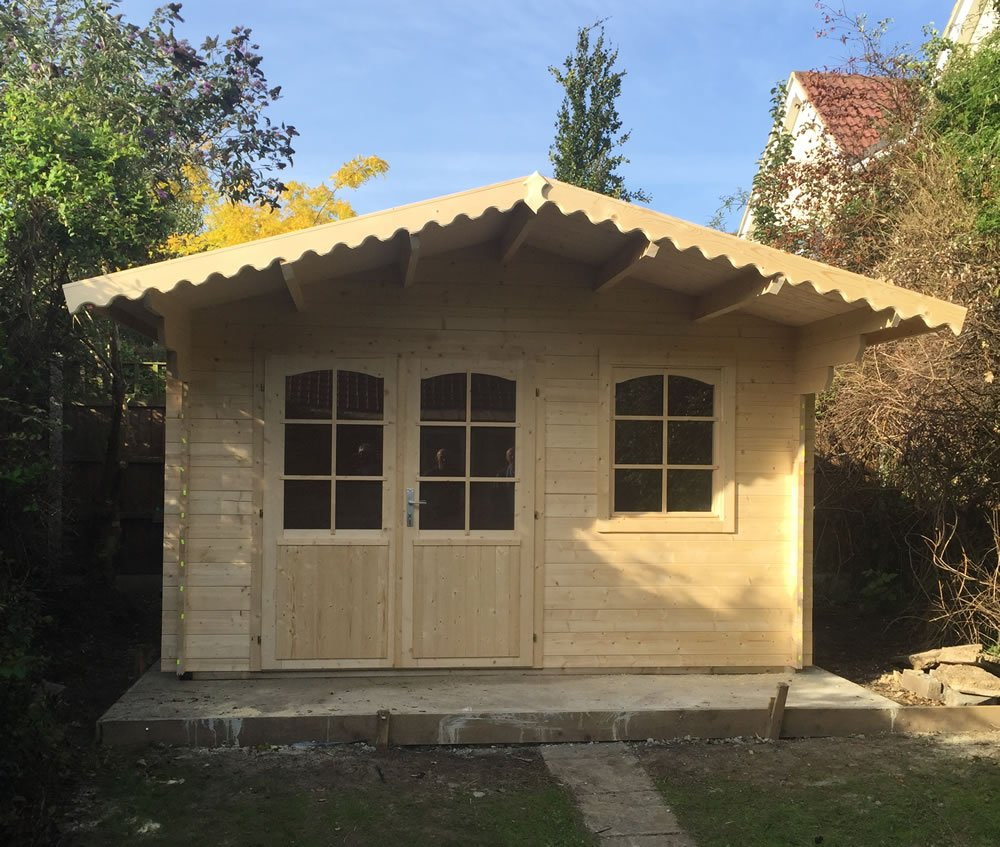 Rosen log cabin with customer made decorative bargeboards