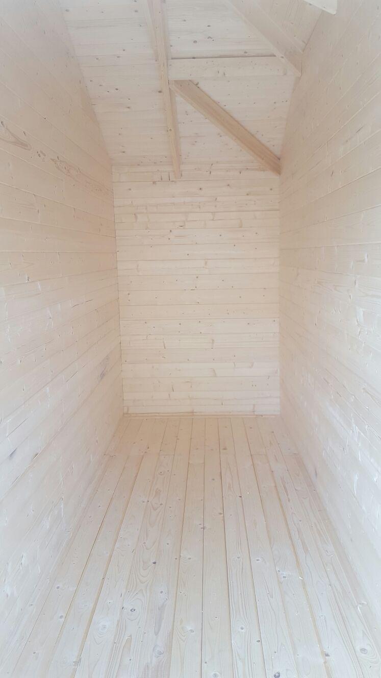 Inside the annexe of the sibella log cabin