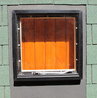 Skylight, opening vent window for your log cabin roof.